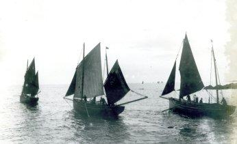 Fishing luggers leaving Looe harbour - cpyright Polperro Heritage Press