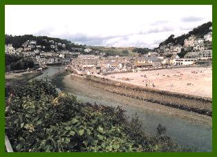 The harbour wall protects East Looe beach - an ample sandy stretch, photo:RJT 8/99